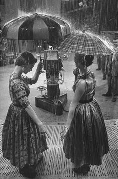 In the rain 1950's vintage photo | umbrellas. This photo makes me happy.