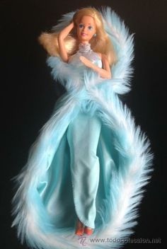 80s Barbie doll that I once had. Her arms moved with a switch on the back. The coolest
