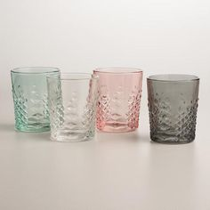 Made in Portugal, our textured double old-fashioned glasses come in four stylish tints that exude retro-inspired glamor.