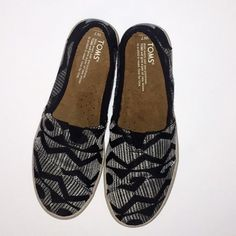 Toms Black & White Tribal Avalon Slip On *W-7* Toms Textured canvas Women's size 7 Avalon Slip On. These are reminiscent of my 90's skater shoes Vans! Easy care, slip on, slip off. These are so cute with cuffed jeans and a Tee! I only wore these once, I needed a smaller size. TOMS Shoes Flats & Loafers