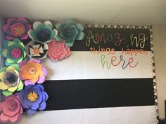 Paper flowers give a classroom wall a pop of color.