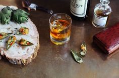 dungeness crab-stuffed artichoke leaves with lemon gremolata (paired with an autumn-spiced sazerac)