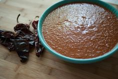 Mole recipe - This one is a great one to start with because although it is the least scary of the authentic mole recipes it is delicious in the way that only mole can be.  It is a rich, complex sauce that is perfect on chicken or pork. #chocolate #Mexican #sauce // reduce, sub or omit raisins; use pepitas instead of nuts