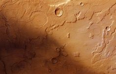 Traces of Martian water    An image from the European Space Agency's Mars Express orbiter, released on May 4, shows channels cut into the terrain of Acidalia Planitia and Tempe Terra on the Red Planet. The channels serve as strong evidence for the existence of water in Mars' past.