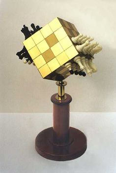 Chess Cubic, invented by Robert Bell, wraps a 96-square board around a cube. Kings, queens and bishops are sheltered by pawns, rooks and knights. Pawns are given two different colors to distinguish their directions of movement.