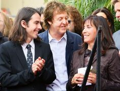 Olivia Harrison, the widow of George Harrison and son Dhani Harrison join Sir Paul McCartney (C) at the ceremony honoring George Harrison of The Beatles with a star on the Hollywood Walk of Fame on April 2009 in Hollywood, California. Olivia Harrison, George Harrison, Paul And Linda Mccartney, Photo Souvenir, The White Album, Les Beatles, Sir Paul, The Fab Four, Wife And Girlfriend