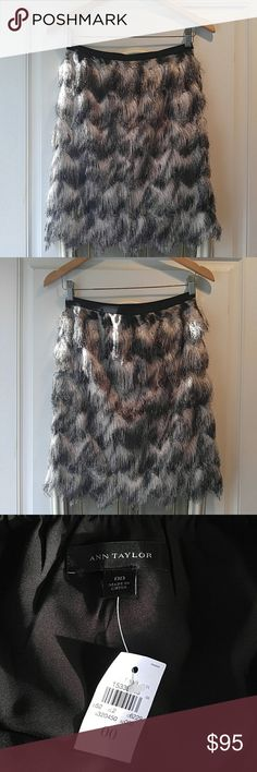 Ann Taylor Feather Skirt NWT black/gray/white feathered skirt with black grosgrain elastic waist band from Ann Taylor. Fully lined. Skirt says size 00 but does not fit like 00 at all. Fits like size 0-2. *From smoke/fragrance/pet free home. No Trades/modeling* Ann Taylor Skirts Mini