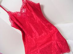 Red Satin Jacquard night gown, Lace accented top and hemline, Adjustable straps  Pristine condition - no issues or flaws to state - never worn  MARKED A SIZE LARGE  PLEASE READ DETAILS AND MEASUREMENTS CAREFULLY. (DOUBLE CHECK THEM) CONTACT US WITH YOUR QUESTIONS/CONCERNS PRIOR TO PURCHASING. DONT HESITATE TO ASK FOR ANY ADDITIONAL MEASUREMENTS, ADDRESS FIGURE CONCERNS OR CLARIFICATION OF LISTING. I WOULD RATHER TAKE THE EXTRA TIME TO MAKE SURE YOU HAVE A GOOD FIT THAN TO HAVE A DISAPPOI...