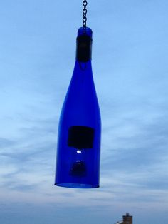 Solar powered lights made from liquor bottles