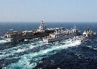 The nuclear powered aircraft carrier USS Enterprise (CVN 65), fast combat support ship USS Detroit (AOE 4), and the guided missile cruiser USS Gettysburg (CG 64) perform a replenishment at sea.