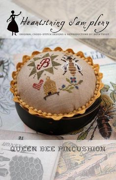 Pre-order 2018 Nashville Market HEARTSTRING SAMPLERY Queen Bee Pincushion counted cross stitch patterns at thecottageneedle.com by thecottageneedle