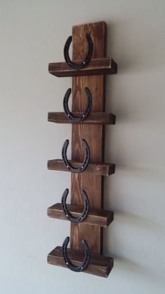Make a little bigger with horseshoes on the side for towel storage.