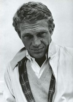 Steve Mcqueen, collared shirt, nice v neck and windbreaker jacket