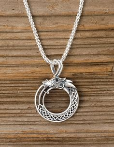Viking Dragon Pendant. Oxidized sterling silver with a tiny, glittering black cubic zirconia eye. - Gaelsong // The Midgard Serpent of Norse mythology was so large it encircled the earth, holding its own tail. Inspired by Viking knotwork art, this sea serpent recalls the fantastical world of legend.