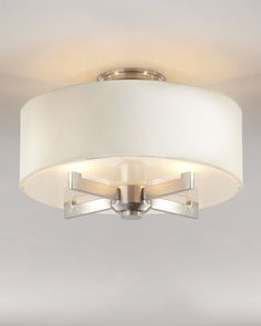 Remove eyesores such as tacky or dated light fixtures. The replacement does not have to be high end just clean and simple like this example. Silver Satin Ceiling Fixture at Horchow.
