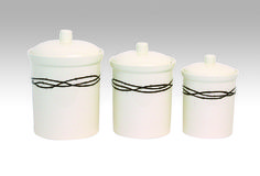 """Heavy ceramic canisters with textured deep brown barbwire accents. Largest canister measures 6 ¾"""" in diameter x high, smallest measures 5 ¼"""" in diameter x high. Ceramic Canister Set, Kitchen Canister Sets, Western Kitchen Decor, Western Decor, Country Kitchen, Western Bathrooms, Cowboy Chic, Dinnerware Sets, Ceramics"""