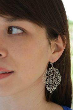 Free pattern for these silver wire knit earrings on the Knitter's Pride blog from Mari Chiba of Mari Knits