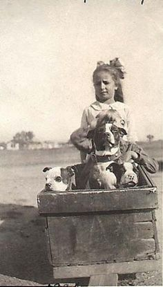 Vintage. Can you see the 2nd child whose lap has a dog on it?