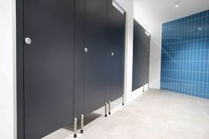 Cost Effective yet stylish with great use of coloured wall. Classic Floors, Toilet, Cubicle, Timber Veneer, Locker Storage, Wall Colors, Urinals, Commercial Bathroom Designs, Bathroom Design