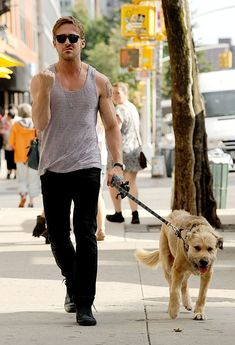 Ryan Gosling pulls a funny face at the paparazzi as he walks his beloved dog George in New York.