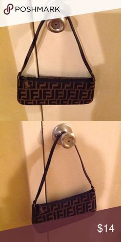 Cute shoulder bag Has long zipper compartment on the inside..gently used. Bags Shoulder Bags