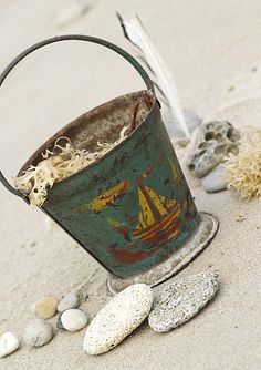 Awesome vintage beach pail. Add here: http://www.completely-coastal.com/2010/07/beach-sand-pails-buckets.html