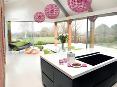 #lime #pink bold colour accents in this gorgeous open plan kitchen/living area www.bespokeinteriors.com