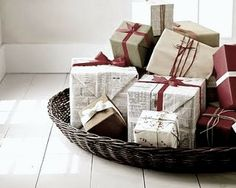 how pretty and resourceful. imagine newspaper wrapped gifts mixed in with kraft paper wrapped presents--great texture