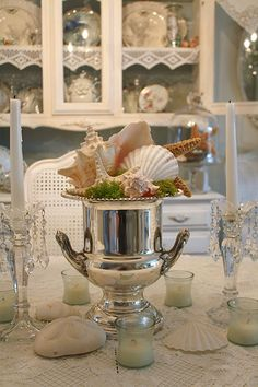 champagne bucket centerpiece shells and sterling silver:) Bucket Centerpiece, Shell Centerpieces, Coastal Style, Coastal Decor, Coastal Living, Coastal Curtains, Coastal Bedding, Modern Coastal, Coastal Furniture