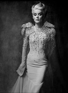 Daphne Guinness a designer who's best friend was Alexander McQueen and most of her style they created together.
