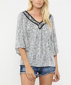 Love this Black & White Stripe V-Neck Cape-Sleeve Top on #zulily! #zulilyfinds