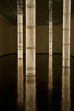 DIY column decor with some strings of lights. Cerith Wyn Evans, Installation at Bergen Kunsthall (2011).