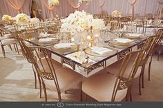 Mirrored table featuring white orchids, garden roses, peonies and hydrangea. @grace_ormonde @wedding_style