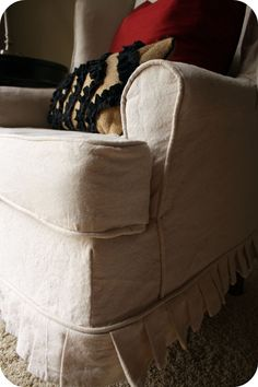 Update a chair, check out this lovely slipcovered wingback chair!