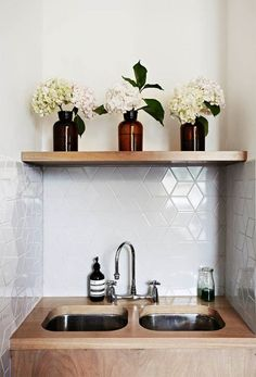 bathroom with white geometric tiles and timber vanity - love this!