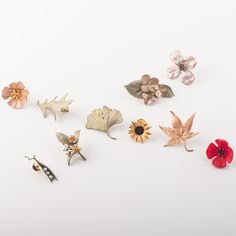 Smaller than his traditional brooch pins, Michael Michaud's lapel pin collection features 14 botanicals. Each pin secures with a jewelry clutch (tie tack). Great for adorning an overcoat, scarf, or accenting a simple outfit. Find these pieces and more at https://www.bestamericanarts.com/search/lapel+pin