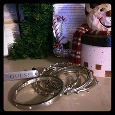"NWT Guess Brand Bangle Set Brand New with tags! Guess Brand set of 8 silver bangles. Each is gorgeous in its detail, one has Guess ""G"". So beautiful  Guess Jewelry Bracelets"