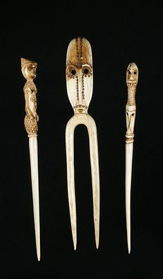 Africa | Three hair pins from the Zande people of DR Congo | Ivory | late 20th century.