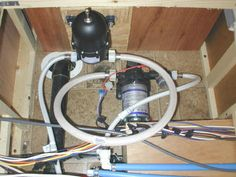 I added a small accumulator tank at the output of the water pump to cut the noise of excessive pump cycling. This was a simple installation since the pump was already hooked up with threaded hoses. One additional hose completed the installation.
