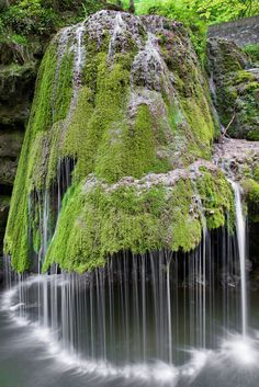 Bigar Waterfall The water on this waterfall in Romania rolls off of a green carpet of moss that covers the rock formation — which results in a magically soft display, much unlike a roaring waterfalls.