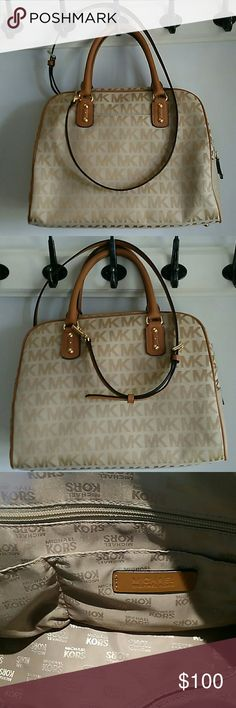 Michael Kors Handbag Michael Kors Large Satchel Handbag with Strap,  signature colors and design,  neautral colors  tan and beige wear with anything,  leather strap metal has Michael Kors written on it, large inside with many pockets,  barely used, in excellent condition Michael Kors Bags Satchels