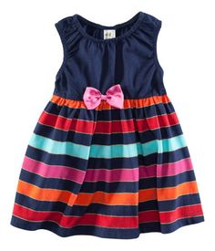 navy multi striped dress with bow detail. perfect for the holidays!