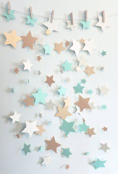 This sassy garland is constructed of 3 different sizes of die-cut mint green, ivory, and gold shimmer stars cut from heavy card stock then sewn together with thread. Stars measure 1, 2, and 3 inches wide. Perfect to drape from the ceiling, buffet tables, doorways, or greenery. You