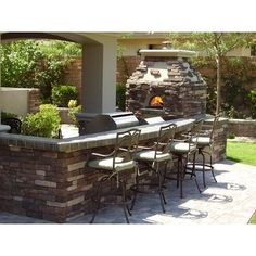 outside grill, wood oven (for pizza night obviously), and bar for entertaining. A must for any wonderful backyard :)