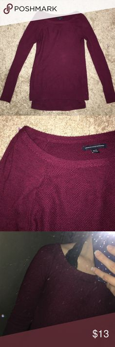 """Maroon American Eagle Sweater Warm and Comfy sweater! It's a size XS but I normally wear a Small and it wears nicely, just a little snug on my arms. Little wear shown if any. Not extremely thick, but I wouldn't call it thin either. Definitely not a """"baggy"""" sweater. All offers are considered! More maroon colored than red! American Eagle Outfitters Sweaters Crew & Scoop Necks"""