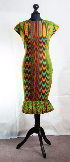 Item Overview - Short African Print dress - Materials: African Print, zipper at the back - only two available in UK size 6 and 12 - Available to ship immediately Item details - Short African print dress with zip at the right side and large plit gathers at the bottom part of dress - Perfect for a professional look Available in UK size 12 (inches) bust 36.5, waist 31, hips 40, full length 39, sleeve 3.5 UK size 6 (inches) bust 31, waist 26, hips 32, full length 38, sleeve 3.5