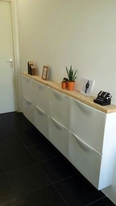 A tidy hall at. Ikea cabinets and a wooden board from the Karwei. A tidy hall at. Ikea cabinets and a wooden board from the Karwei. A tidy hall at. Ikea cabinets and a wooden board from the Karwei. A tidy hall at. Ikea cabinets and a wooden board from … Hallway Storage, Ikea Storage, Storage Ideas, Storage Boxes, Small Apartments, Small Spaces, Small Hallways, Ikea Cabinets, Shoe Cabinets