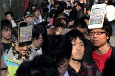 iQUEUE Apple fans outside a Tokyo store wait to purchase the iPhone 4S