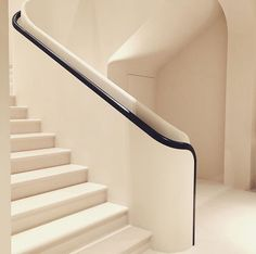 White stairs with black handrail