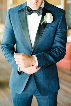 This groom looks handsome in a navy Hugo Boss tuxedo | Brides.com
